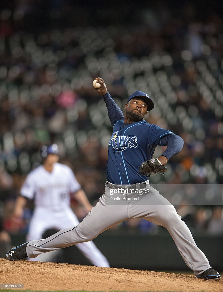 <a gi-track='captionPersonalityLinkClicked' href=/galleries/search?phrase=Fernando+Rodney&family=editorial&specificpeople=547291 ng-click='$event.stopPropagation()'>Fernando Rodney</a> #56 of the Tampa Bay Rays pitches enroute to the save against the Colorado Rockies at Coors Field on May 3, 2013 in Denver, Colorado. The Rays beat the Rockies 7-4 in ten innings.