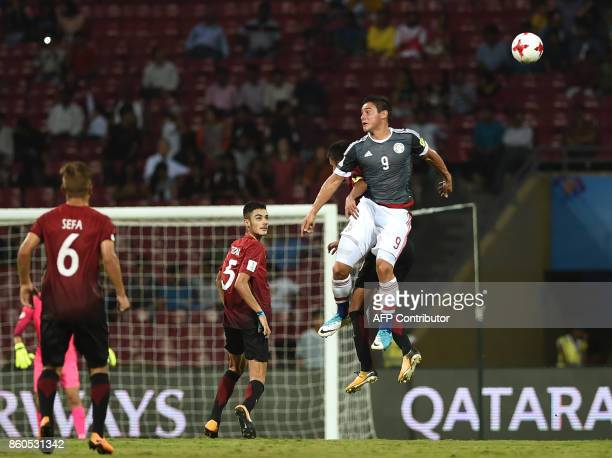 Fernando Romero of Paraguay vie for the ball during the group stage football match between Turkey and Paraguay in the FIFA U17 World Cup at the...