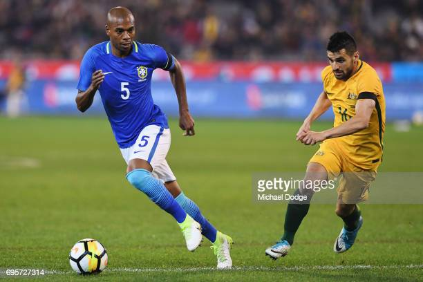 Fernando Roza of Brazil the ball from Aziz Behich of Australia during the Brasil Global Tour match between Australian Socceroos and Brazil at...