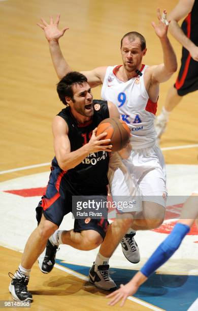 Fernando San Emeterio #19 of Caja Laboral competes with Ramunas Siskauskas #9 of CSKA Moscow during the Euroleague Basketball 20092010 Play Off Game...