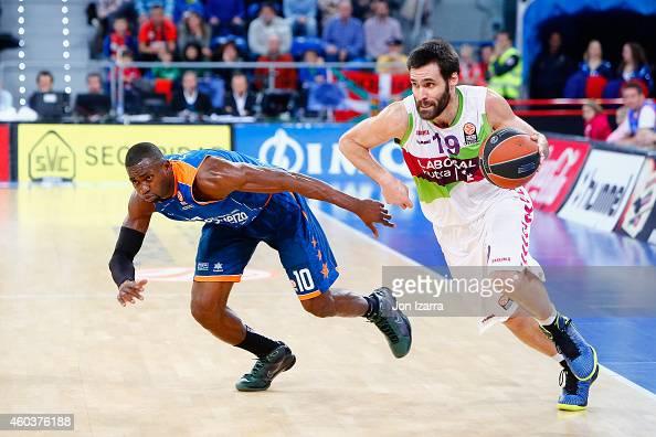 Fernando San Emeterio #19 of Laboral Kutxa Vitoria competes with Romain Sato #10 of Valencia Basket during the 20142015 Turkish Airlines Euroleague...