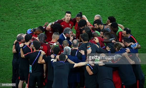 Fernando Santos instructs players huddling prior to the penalty shootout during the UEFA EURO 2016 quarter final match between Poland and Portugal at...