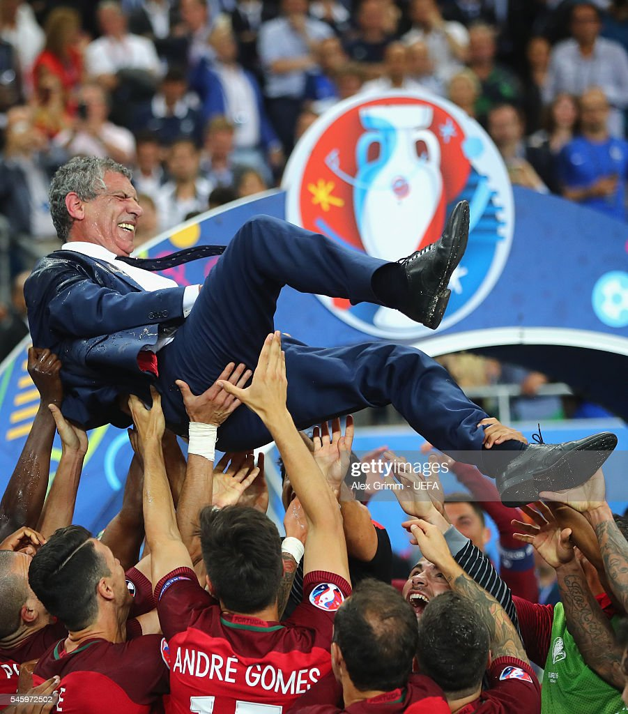 Fernando Santos manager of Portugal is thrown into the air by his players after his side win 1-0 against France during the UEFA EURO 2016 Final match between Portugal and France at Stade de France on July 10, 2016 in Paris, France.