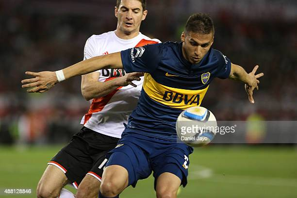 Fernando Tobio of Boca Juniors and Lucas Alario of River Plate fight for the ball during a match between River Plate and Boca Juniors as part of 24th...