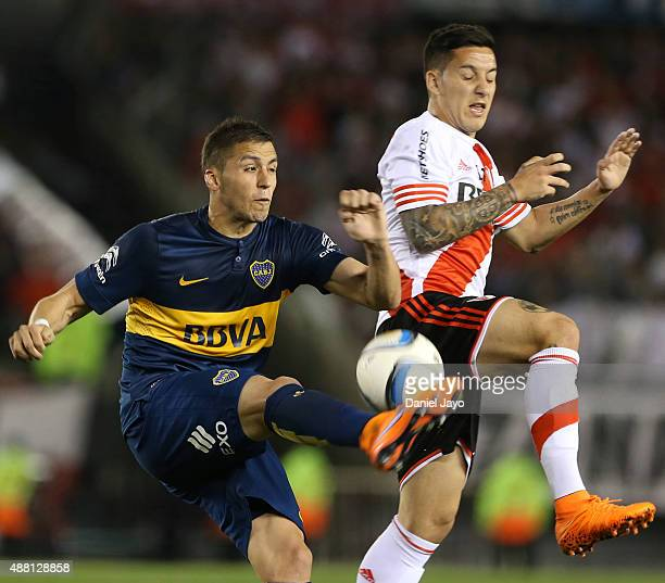 Fernando Tobio of Boca Juniors and Sebastian Driussi of River Plate battle for the ball during a match between River Plate and Boca Juniors as part...