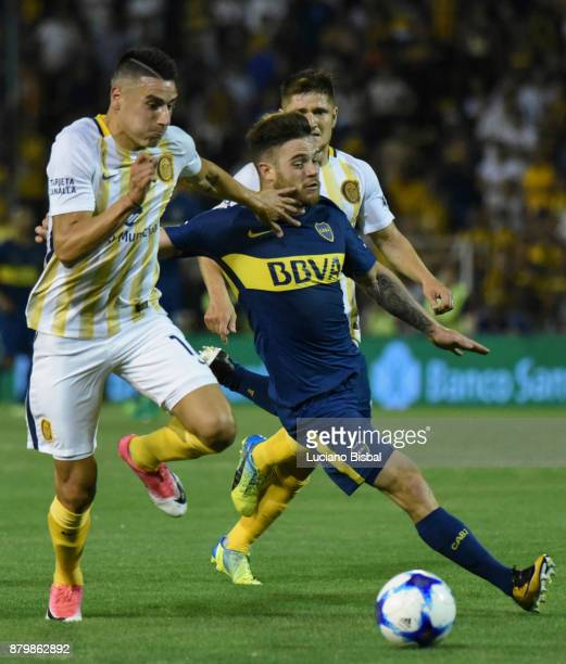 Fernando Tobio of Rosario Central fights for the ball with Nahitan Nandez of Boca Juniors during a match between Rosario Central and Boca Juniors as...