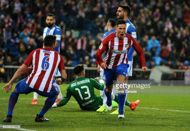 Fernando Torres #9 of Atletico de Madrid scores to make it 10 during the La Liga match between Atletico Madrid and CD Leganes at Vicente Calderon on...
