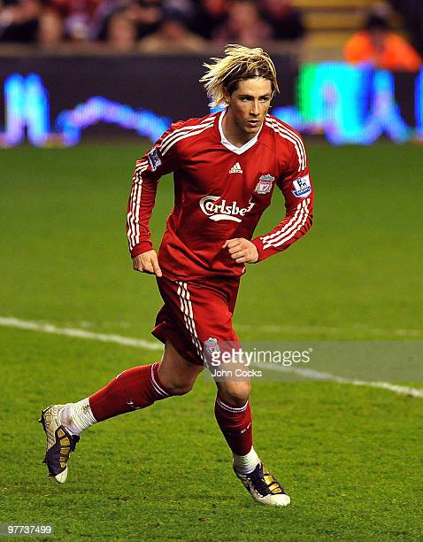 Fernando Torres celebrates after scoring his second goal during the Barclays Premier League match between Liverpool and Portsmouth at Anfield on...
