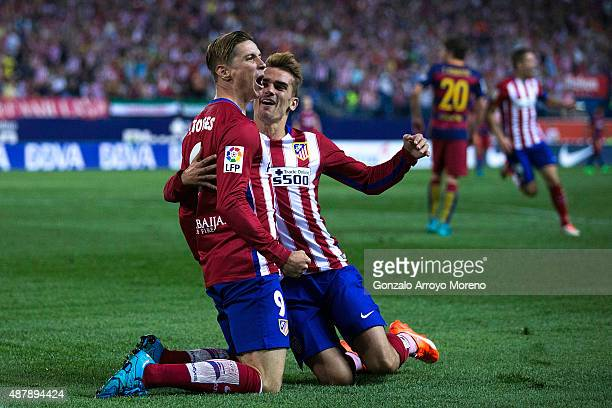 Fernando Torres celebrates scoring their opening goal with teammate Antoine Griezmann during the La Liga match between Club Atletico de Madrid and FC...