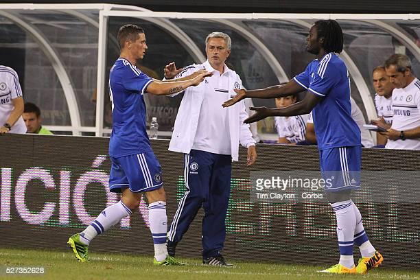 Fernando Torres Chelsea is replaced by Romelu Lukaku as coach Jose Mourinho congratulates him during the Chelsea V AC Milan Guinness International...