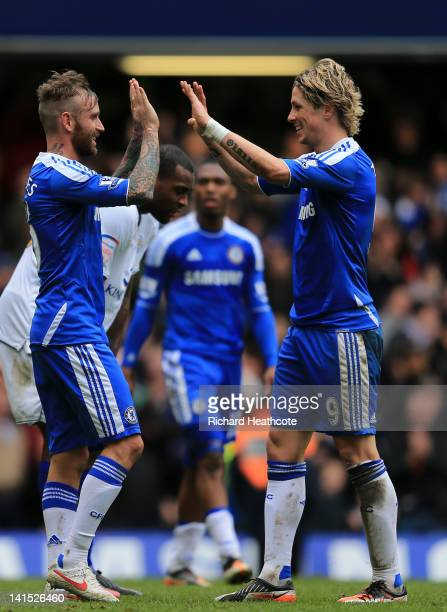 Fernando Torres congratulates Raul Meireles of Chelsea on scoring their fifth goal during the FA Cup sixth round match between Chelsea and Leicester...