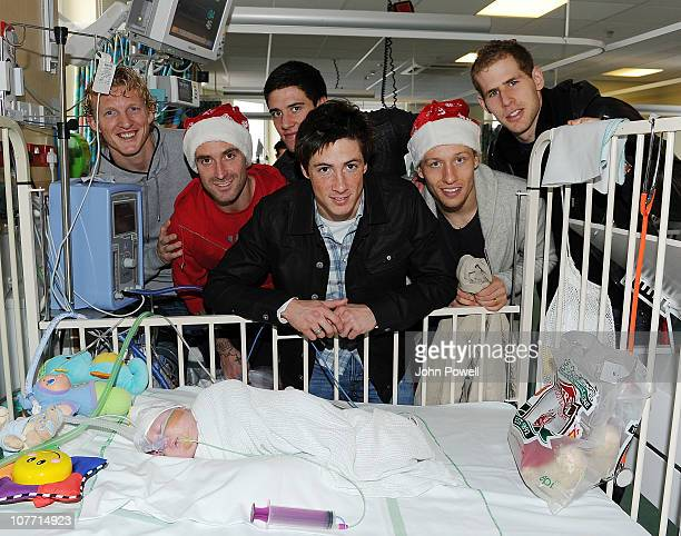 Fernando Torres Dirk Kuyt Lucas Leiva Martin Kelly Raul Meirles and Peter Gulacsi of Liverpool FC visit children at Alder Hey Children's Hospital on...