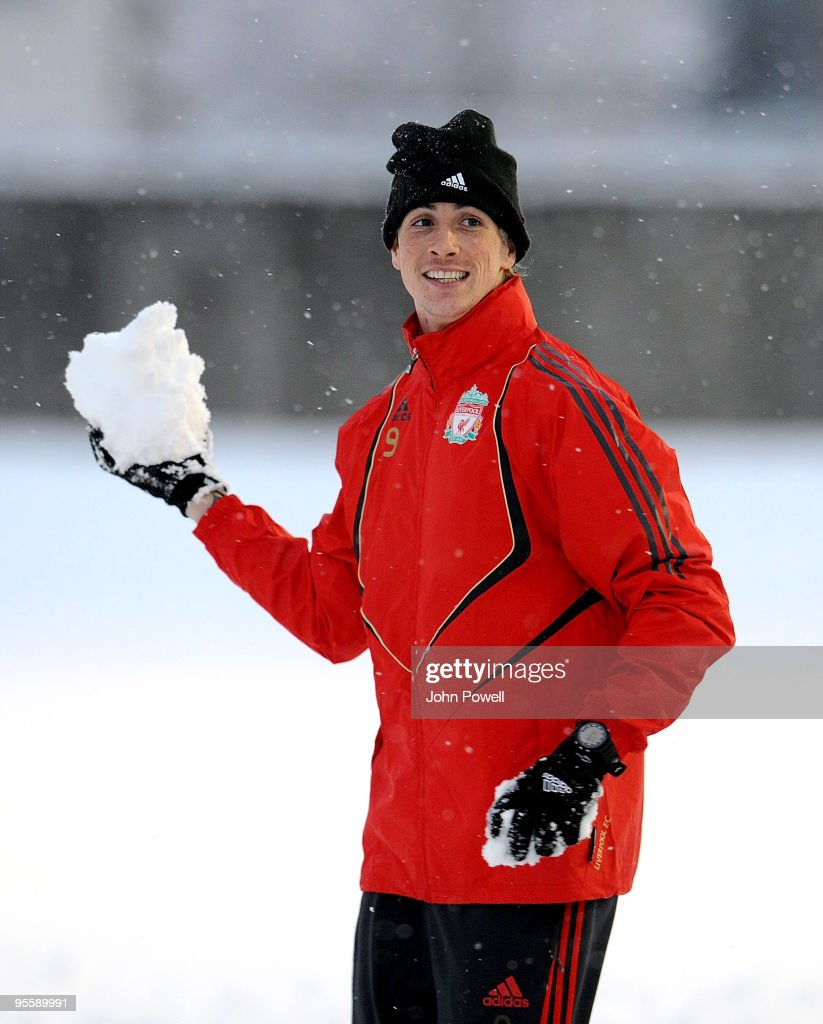 Fernando Torres enjoys the snowfall during a training session at Melwood Training Ground on January 5, 2010 in Liverpool, England.