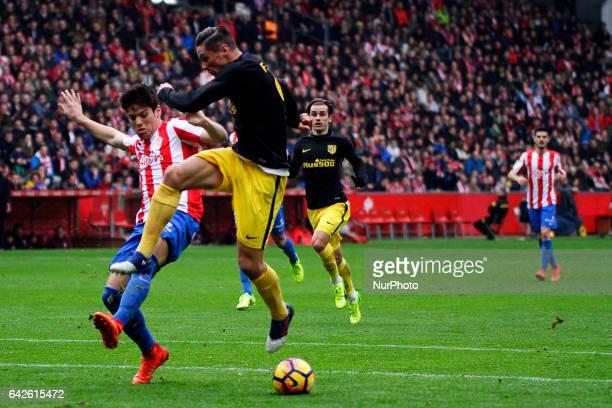 Fernando Torres forward of Atletico de Madrid battles for the ball with Jorge Mere defender of Sporting de Gijon during the La Liga Santander match...