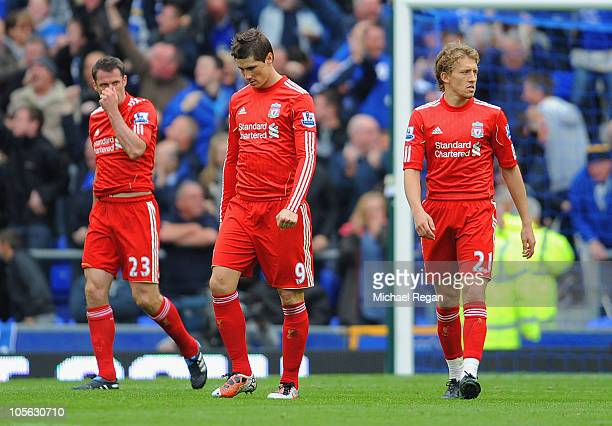 Fernando Torres Jamie Carragher and Lucas of Liverpool look dejected after conceding a second goal during the Barclays Premier League match between...