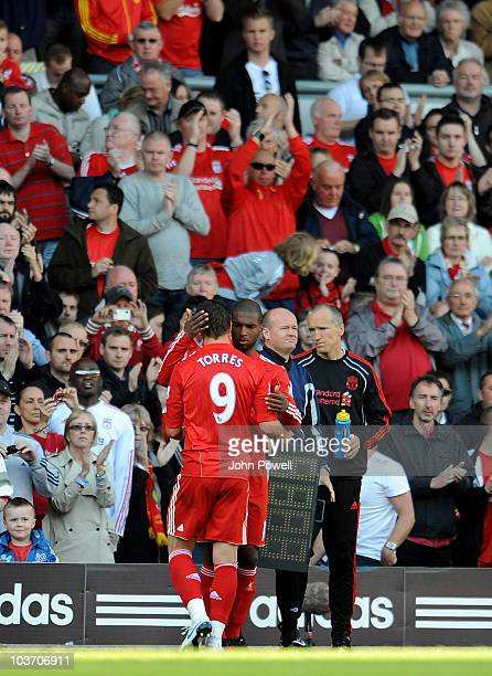 Fernando Torres Liverpool walks off the field as he is substituted by team mate Ryan Babel during the Barclays Premier League match between Liverpool...