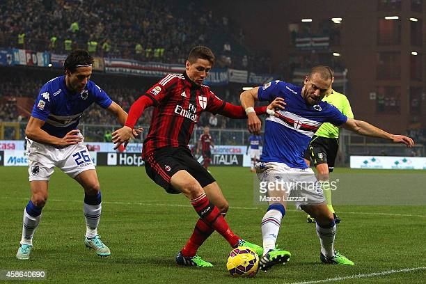 Fernando Torres of AC Milan competes for the ball with Matias Agustin Silvestre and Lorenzo De Silvestri of UC Sampdoria during the Serie A match...