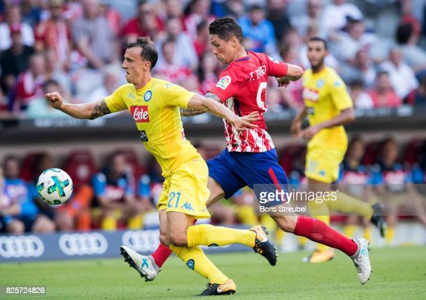 Fernando Torres of Athletico Madrid battles for the ball with Vlad Chiriches of SSC Napoli during the Audi Cup 2017 match between Club Atletico de...