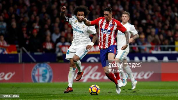 Fernando Torres of Atletico de Madrid and Marcelo of Real Madrid battle for the ball during a match between Atletico Madrid and Real Madrid as part...
