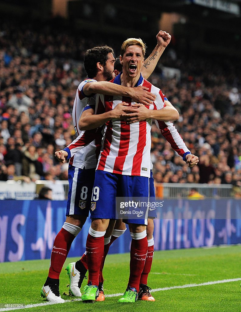 <a gi-track='captionPersonalityLinkClicked' href=/galleries/search?phrase=Fernando+Torres&family=editorial&specificpeople=194755 ng-click='$event.stopPropagation()'>Fernando Torres</a> of Atletico de Madrid celebrates after scoring Atletico's opening goal during the Copa del Rey Round of 16, Second leg match between Real Madrid and Atletico de Madrid at Estadio Santiago Bernabeu on January 15, 2015 in Madrid, Spain.
