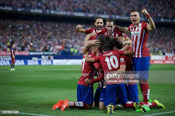 Fernando Torres of Atletico de Madrid celebrates scoring their opening goal with teammates during the La Liga match between Club Atletico de Madrid...