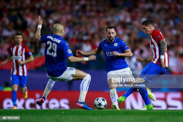 Fernando Torres of Atletico de Madrid competes for the ball with Danny Drinkwater and Yohan Benalouane of Leicester City FC during the UEFA Champions...