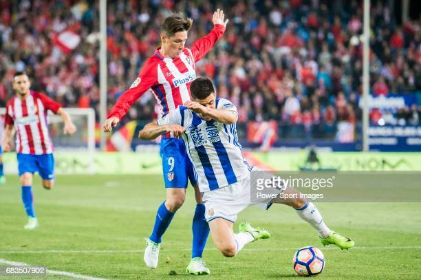 Fernando Torres of Atletico de Madrid competes for the ball with Yuri Berchiche Izeta of Real Sociedad during their La Liga match between Atletico de...