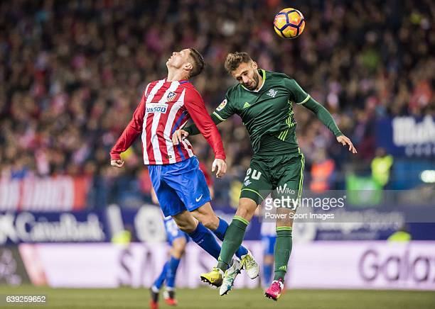 Fernando Torres of Atletico de Madrid fights for the ball with German Pezzella of Real Betis Balompie during their La Liga 201617 match between...