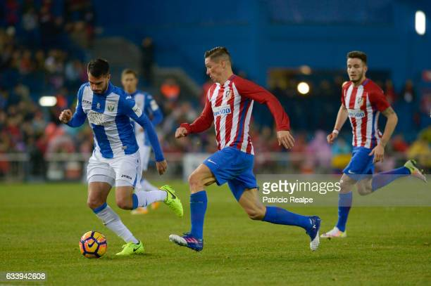 Fernando Torres of Atletico de Madrid fights for the ball with Pablo Insua of Leganes during a match between Atletico Madrid and Leganes at Vicente...