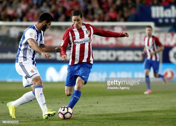 Fernando Torres of Atletico de Madrid in action against Alvaro Odriozola of Real Sociedad during the La Liga match between Atletico de Madrid and...