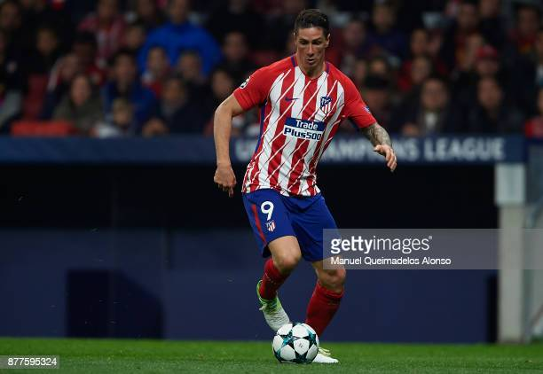 Fernando Torres of Atletico de Madrid runs with the ball during the UEFA Champions League group C match between Atletico Madrid and AS Roma at...