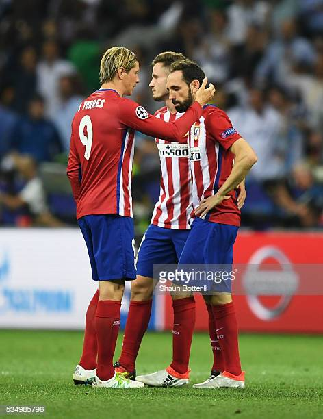 Fernando Torres of Atletico Madrid and Juanfran of Atletico Madrid show their dejection during the UEFA Champions League Final match between Real...