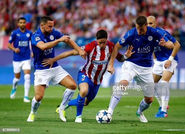 Fernando Torres of Atletico Madrid and Robert Huth of Leicester City battle for the ball during the UEFA Champions League Quarter Final first leg...