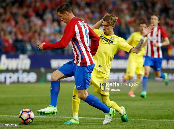 Fernando Torres of Atletico Madrid and Samu Castillejo of Villarreal battle for the ball during the La Liga match between Club Atletico de Madrid and...