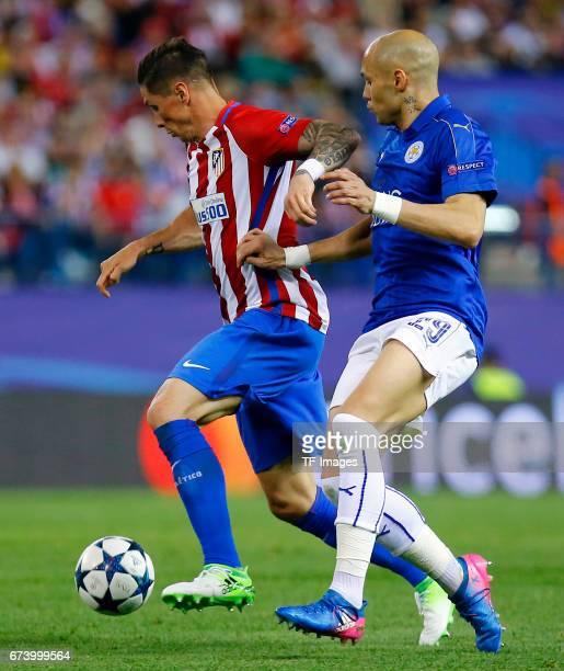 Fernando Torres of Atletico Madrid and Yohan Benalouane of Leicester City battle for the ball during the UEFA Champions League Quarter Final first...