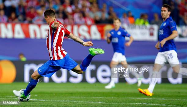 Fernando Torres of Atletico Madrid battle for the ball during the UEFA Champions League Quarter Final first leg match between Club Atletico de Madrid...