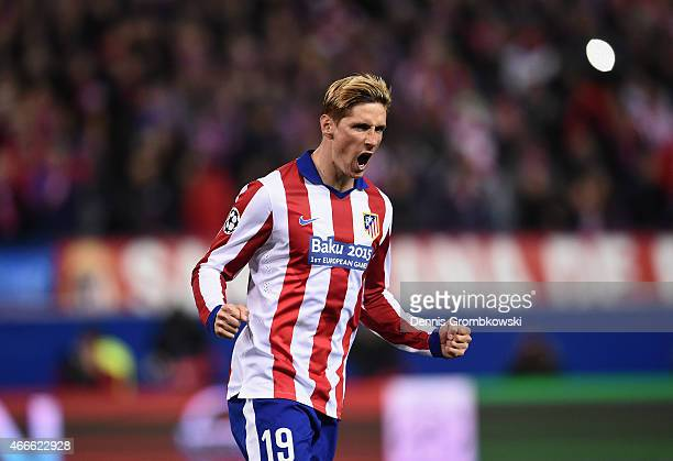 Fernando Torres of Atletico Madrid celebrates scoring in the penalty shoot out during the UEFA Champions League round of 16 match between Club...