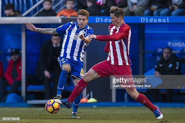 Fernando Torres of Atletico Madrid duels for the ball with Francisco Femenia of Deportivo Alaves during the La Liga match between Deportivo Alaves...