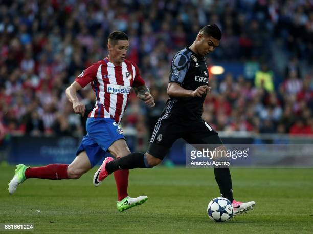 Fernando Torres of Atletico Madrid in action against Carlos Casemiro of Real Madrid during the UEFA Champions League semi final second leg match...