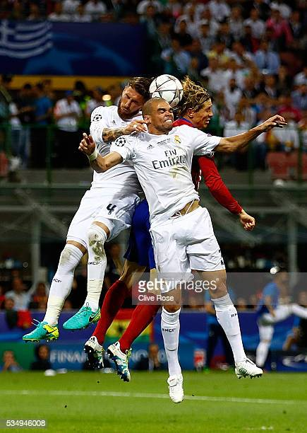 Fernando Torres of Atletico Madrid is challemged by Sergio Ramos of Real Madrid and Pepe of Real Madrid during the UEFA Champions League Final match...