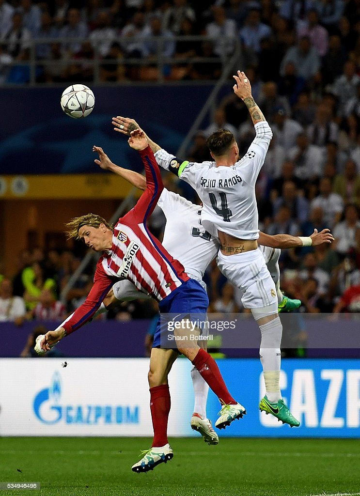<a gi-track='captionPersonalityLinkClicked' href=/galleries/search?phrase=Fernando+Torres&family=editorial&specificpeople=194755 ng-click='$event.stopPropagation()'>Fernando Torres</a> of Atletico Madrid is challemged by Sergio Ramos of Real Madrid and <a gi-track='captionPersonalityLinkClicked' href=/galleries/search?phrase=Pepe+-+Portuguese+Soccer+Player&family=editorial&specificpeople=4401229 ng-click='$event.stopPropagation()'>Pepe</a> of Real Madrid during the UEFA Champions League Final match between Real Madrid and Club Atletico de Madrid at Stadio Giuseppe Meazza on May 28, 2016 in Milan, Italy.