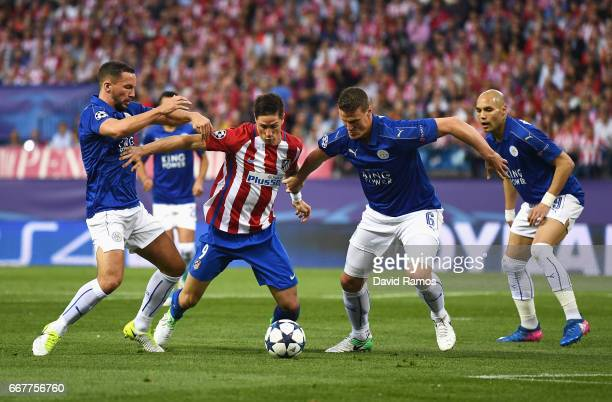 Fernando Torres of Atletico Madrid is challenged by Danny Drinkwater and Robert Huth of Leicester City during the UEFA Champions League Quarter Final...