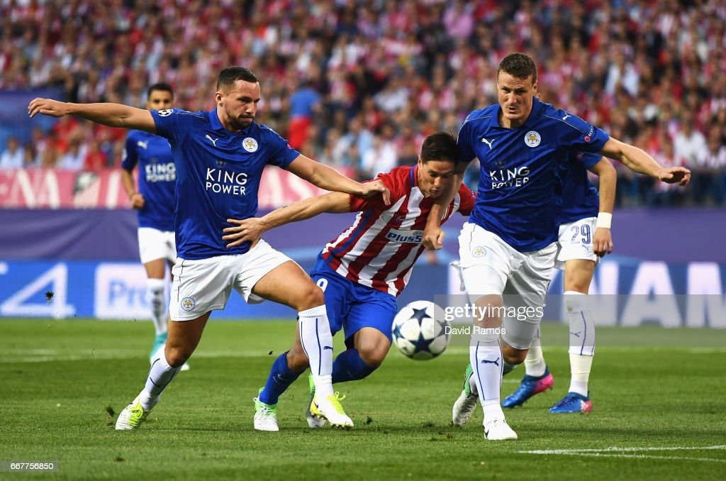 Fernando Torres of Atletico Madrid is challenged by Danny Drinkwater (L) and Robert Huth of Leicester City during the UEFA Champions League Quarter Final first leg match between Club Atletico de Madrid and Leicester City at Vicente Calderon Stadium on April 12, 2017 in Madrid, Spain.