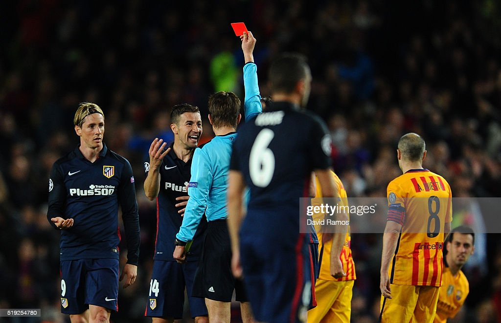 Fernando Torres of Atletico Madrid (L) is shown a red card by referee <a gi-track='captionPersonalityLinkClicked' href=/galleries/search?phrase=Felix+Brych&family=editorial&specificpeople=707645 ng-click='$event.stopPropagation()'>Felix Brych</a> and is sent off during the UEFA Champions League quarter final first leg match between FC Barcelona and Club Atletico de Madrid at Camp Nou on April 5, 2016 in Barcelona, Spain.