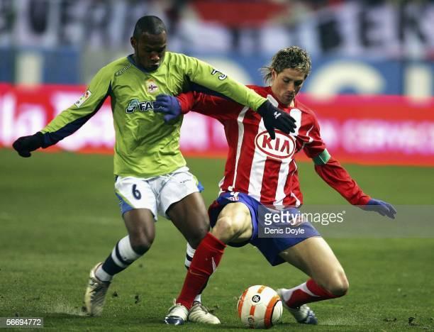 Fernando Torres of Atletico Madrid is tackled by Julian de Guzman of Deportivo La Coruna during a Primera Liga match between Atletico Madrid and...