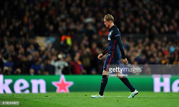 Fernando Torres of Atletico Madrid looks dejected as he is shown a red card and is sent off during the UEFA Champions League quarter final first leg...