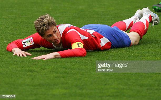 Fernando Torres of Atletico Madrid takes a fall during the Primera Liga match between Atletico Madrid and Mallorca at the Vicente Calderon stadium on...