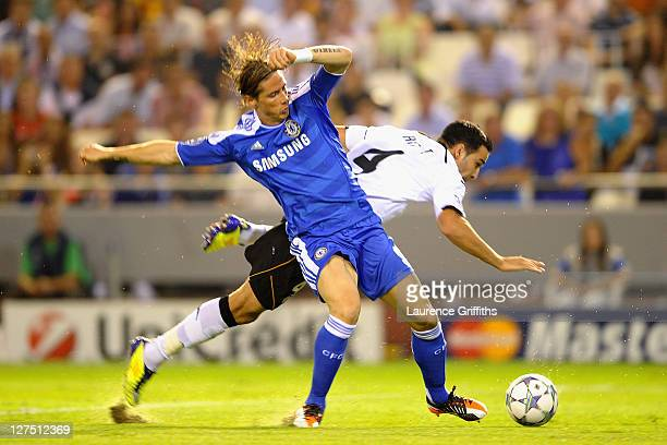 Fernando Torres of Chelsea and Adil Rami of Valencia battle for the ball during the UEFA Champions League Group E match between Valencia CF and...