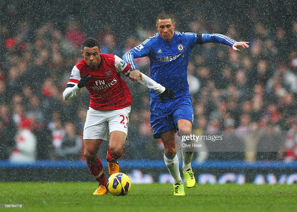 Fernando Torres of Chelsea battles with Francis Coquelin of Arsenal during the Barclays Premier League match between Chelsea and Arsenal at Stamford Bridge on January 20, 2013 in London, England.