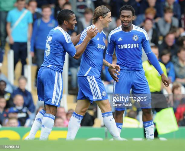 Fernando Torres of Chelsea celebrates Chelsea's goal with Florent Malouda and Daniel Sturridge during a pre season friendly match between Portsmouth...